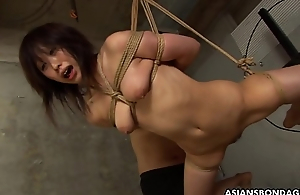 Submissive Oriental bimbo Kana Sato gets roped and sucks cock