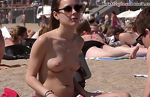 Wonderful suntanned babe Topless on the Beach