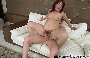 Heeled granny riding cock