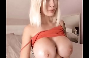 Tow-headed bitch play with her jumbo white tits