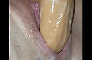 Creamy slit taking gargantuan dildo
